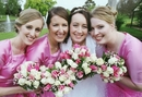 Bridesmaids pretty in pink, with bouquets to match the Bride in white!